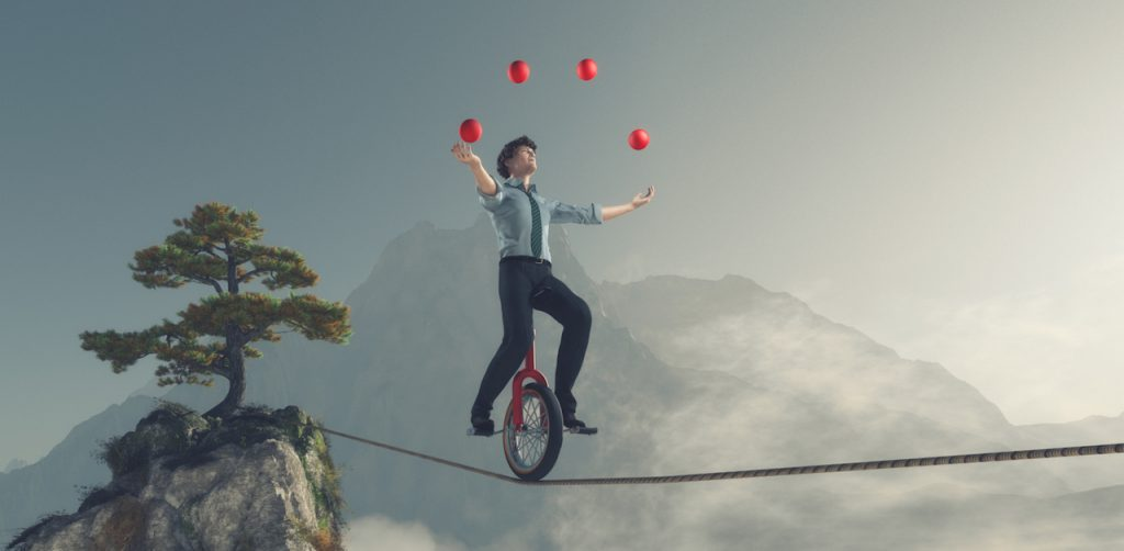 business person juggling